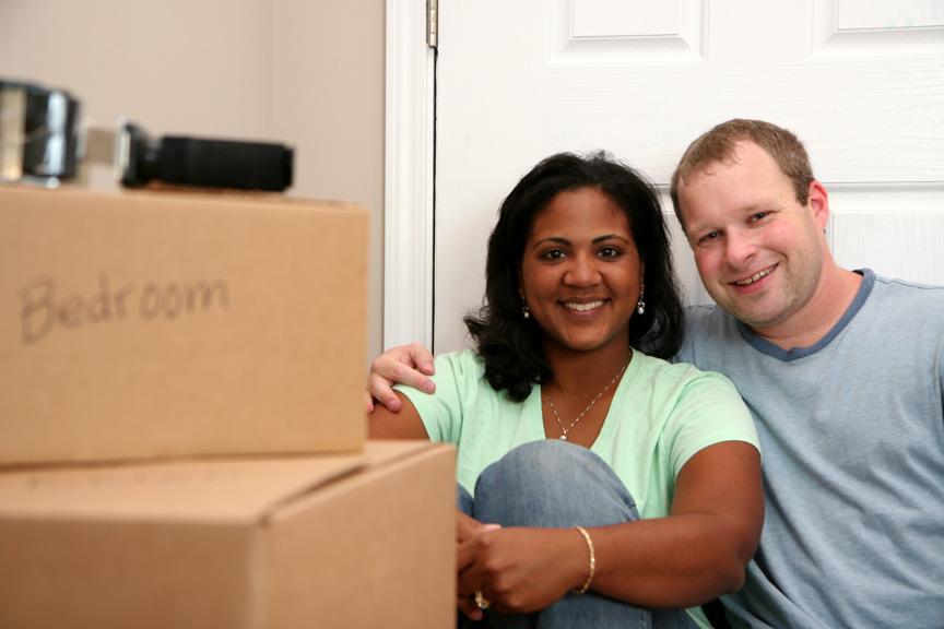 Happy Couple Moving Overseas